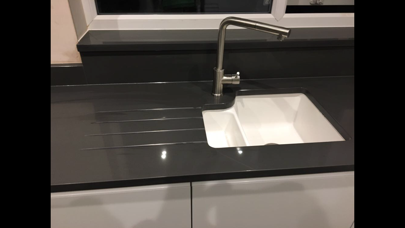 Charcoal Grey Quartz sink and draining grooves